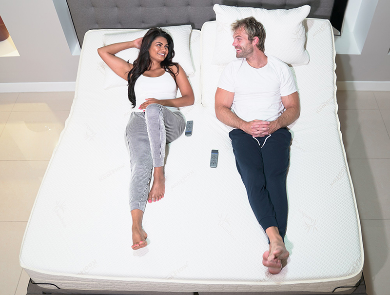 Couple Laying On Air-Pedic Number Bed